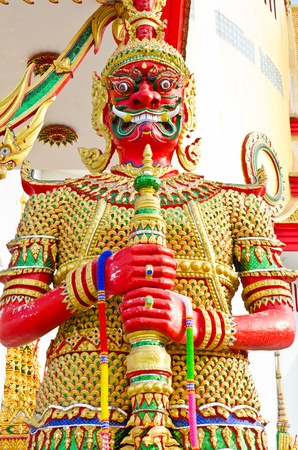 Red giant and golden dress, Thailand. photo