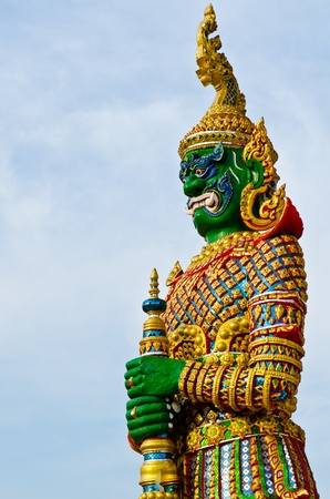 Green giant and golden dress, Thailand. photo
