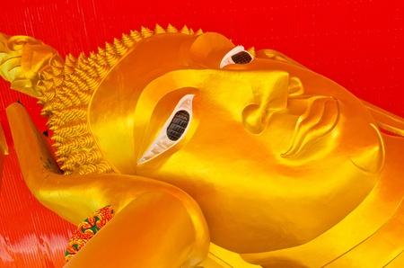 Golden reclining buddha, Thailand. Stock Photo - 12877431