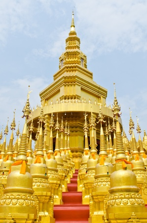 Golden pagoda with blue sky at Wat Pasawangboon temple, Thailand. photo