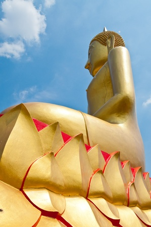 Golden buddha statue with blue sky, Thailand  photo