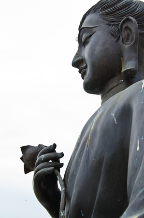 Buddha statue with white sky, Thailand Stock Photo