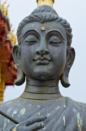 buddha face: Face of black buddha statue, Thailand.