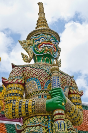 Giant statue with Thai style background, Thailand  photo