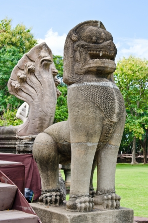 lon: Lion statue made from sand stone at Phimai Historical Park, Thailand