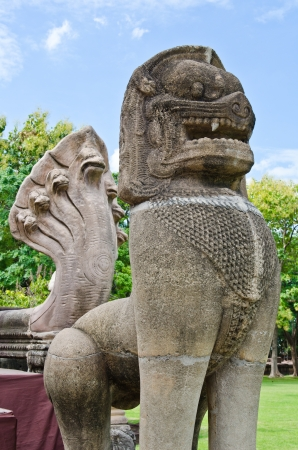 Lion statue made from sand stone at Phimai Historical Park, Thailand