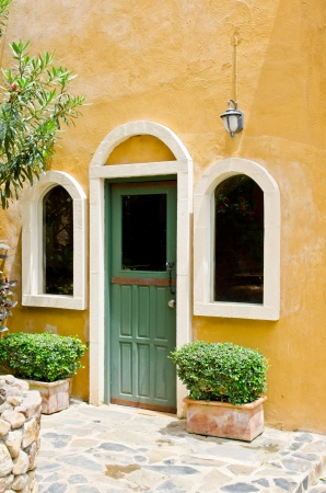 Door and window with yellow wall, Thailand  photo