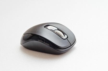 Black computer mouse on white screen, Thailand. photo
