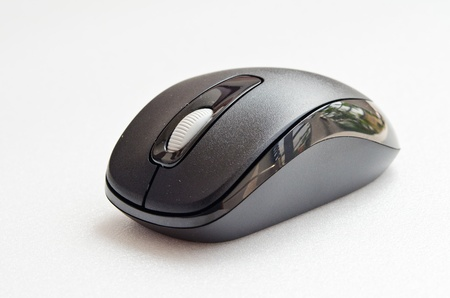 Black computer mouse on white screen, Thailand. Stock Photo - 15548834