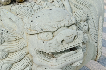 Head of Chinese lion statue, Thailand. photo