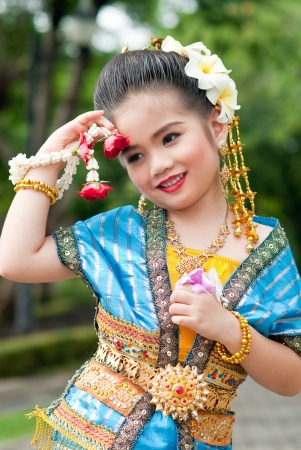 Portrait of the Thai beautiful girl in Thai style traditional suit, Thailand. photo