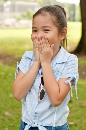 show garden: Portrait of beautiful little asian girl in the park, Thailand. Stock Photo