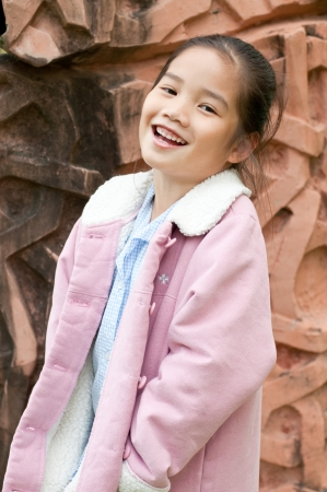 Portrait of lovely asian girl in pink sweater, Thailand. photo