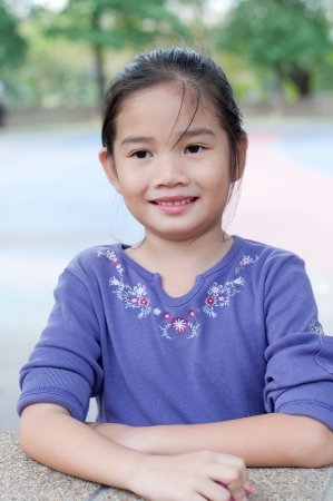 Portrait of lovely asian girl in violet suit, Thailand  photo