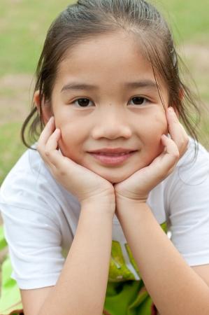 Head shot portrait of lovely asian girl in white T-shirt, Thailand