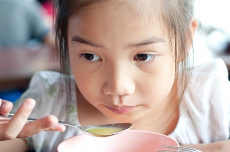 Asian beautiful girl eats soup, Thailand.