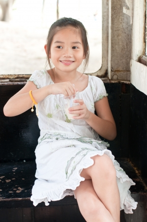 Beautiful asian girl eats ice cream in park, Thailand. photo