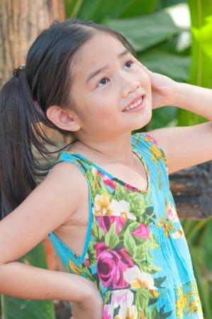 Porttrait of beautiful Thai girl in blue dress , Thailand. photo