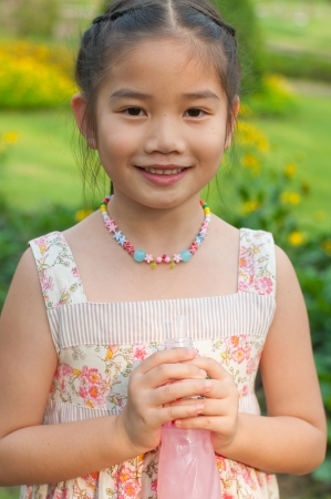 Portrait of happy Thai girl in the garden, Thailand. photo