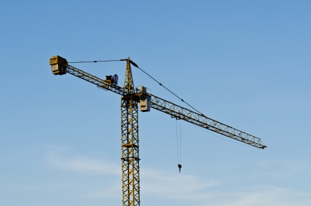 Tower crane with blue sky, Thailand. photo