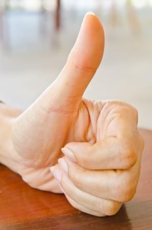 gril: Gril finger show OK symbol, Thailand.