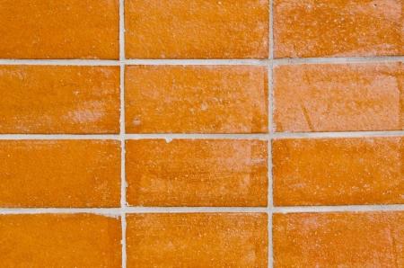 frame less: orange brick wall background, Thailand.