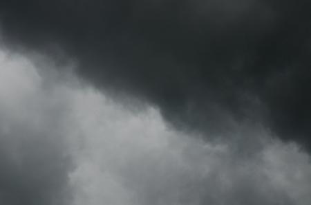 bad weather: Black rainy cloud on white sky, Thailand.