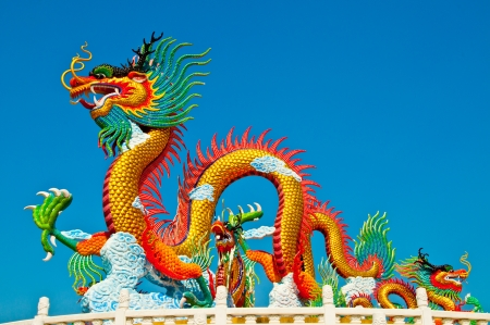 chinese new year dragon: Colorful dragon statue with blue sky at public park, Thailand.