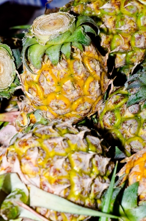 Group of pineapples at the market, Thailand. photo