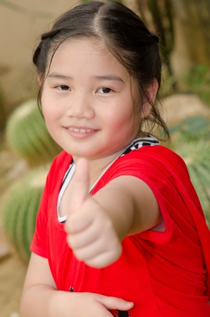 Portrait of Thai style girl in red dress, Thailand. photo