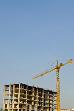 Tower crane and building structure with blue sky, Thailand  photo