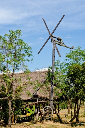 Windmill with hut in countryside, Thailand. photo
