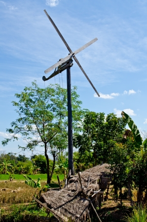 Windmill with blue sky in countryside, Thailand. Stock Photo - 16916824