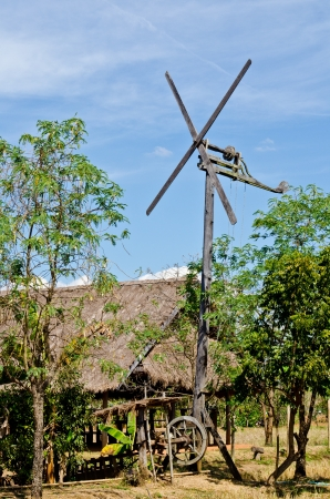 Windmill with hut in countryside, Thailand.