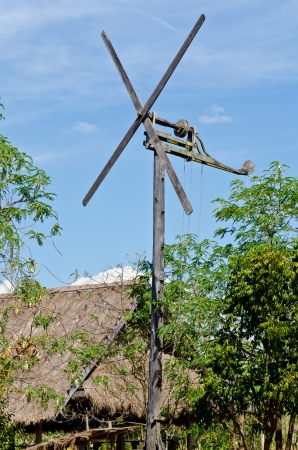Windmill with hut in countryside, Thailand. Stock Photo - 16986280