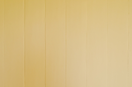 Wood wall coat with yellow paint, Thailand. photo