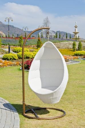 White swing in beautiful garden, Thailand.
