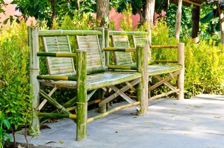 timber bench seat: Bamboo bench in garden, Thailand.