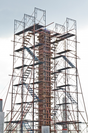 Column with scaffolding in construction site, Thailand.