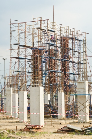 scaffold: Column formwork with scaffolding in construction site, Thailand.