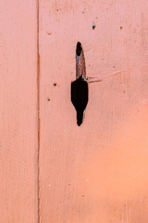Brown wooden wall with black hole, Thailand  photo
