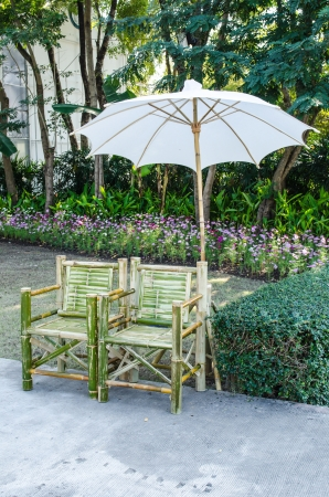 Bamboo bench with umbrella in public park, Thailand. photo