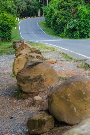 Road and stone in national park, Thailand. photo