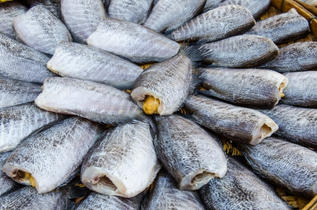 Drying snakeskin gourami fishes at the market, Thailand. photo