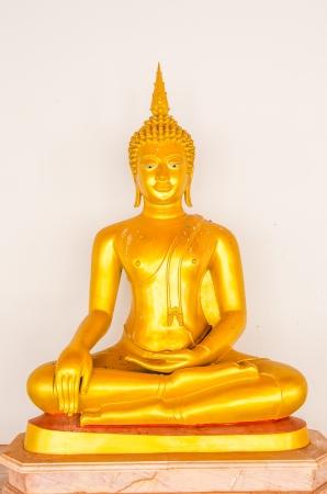 Golden buddha statue on white background, Thailand. photo