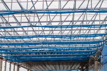 spacing: Steel truss with safety net in construction site, Thailand Editorial
