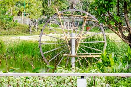 water turbine: Thai style water turbine in park, Thailand Stock Photo