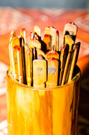 Seam-Si, Chi-Chi Sticks or fortune sticks, shake for future forecast, Thailand photo