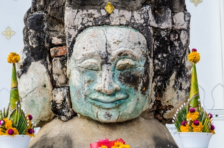 Ancient buddha head, Thailand photo