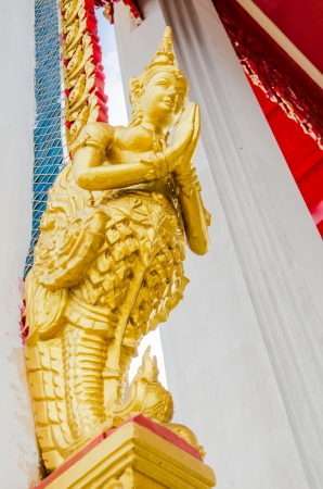 Angel statue at Thai temple, Thailand photo
